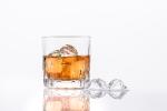Glass of Whiskey on White